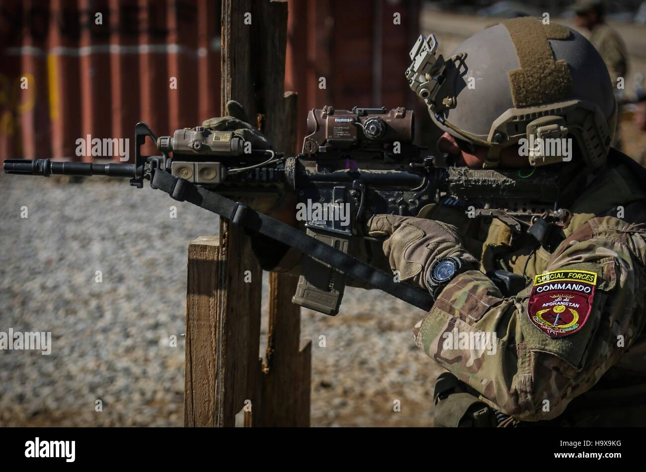 An Afghan special forces commando practices his marksmanship at a shooting range November 1, 2013 in the Kabul province, - Stock Image