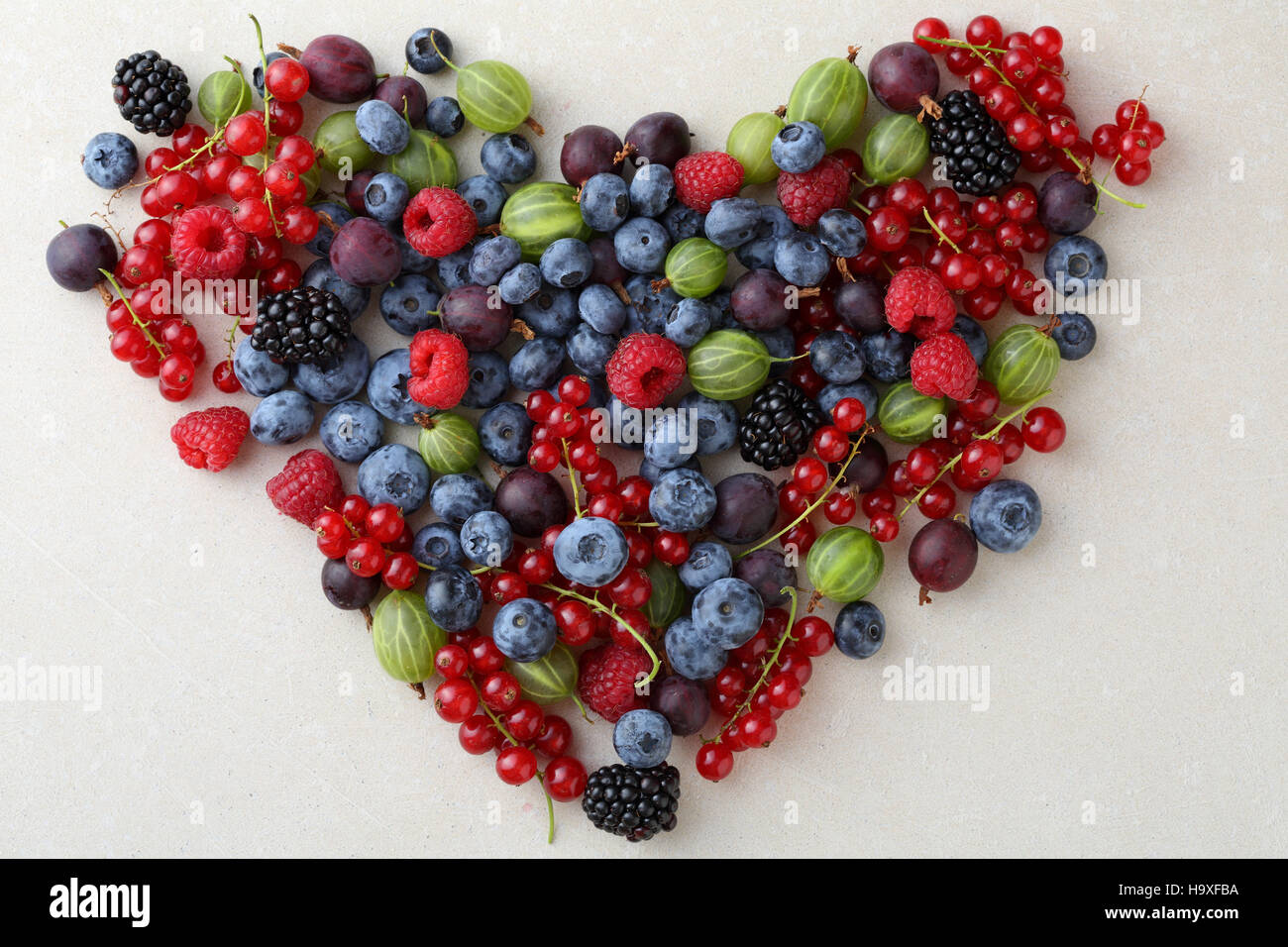 Fresh berries healthy lifestyle concept, love fruits - Stock Image