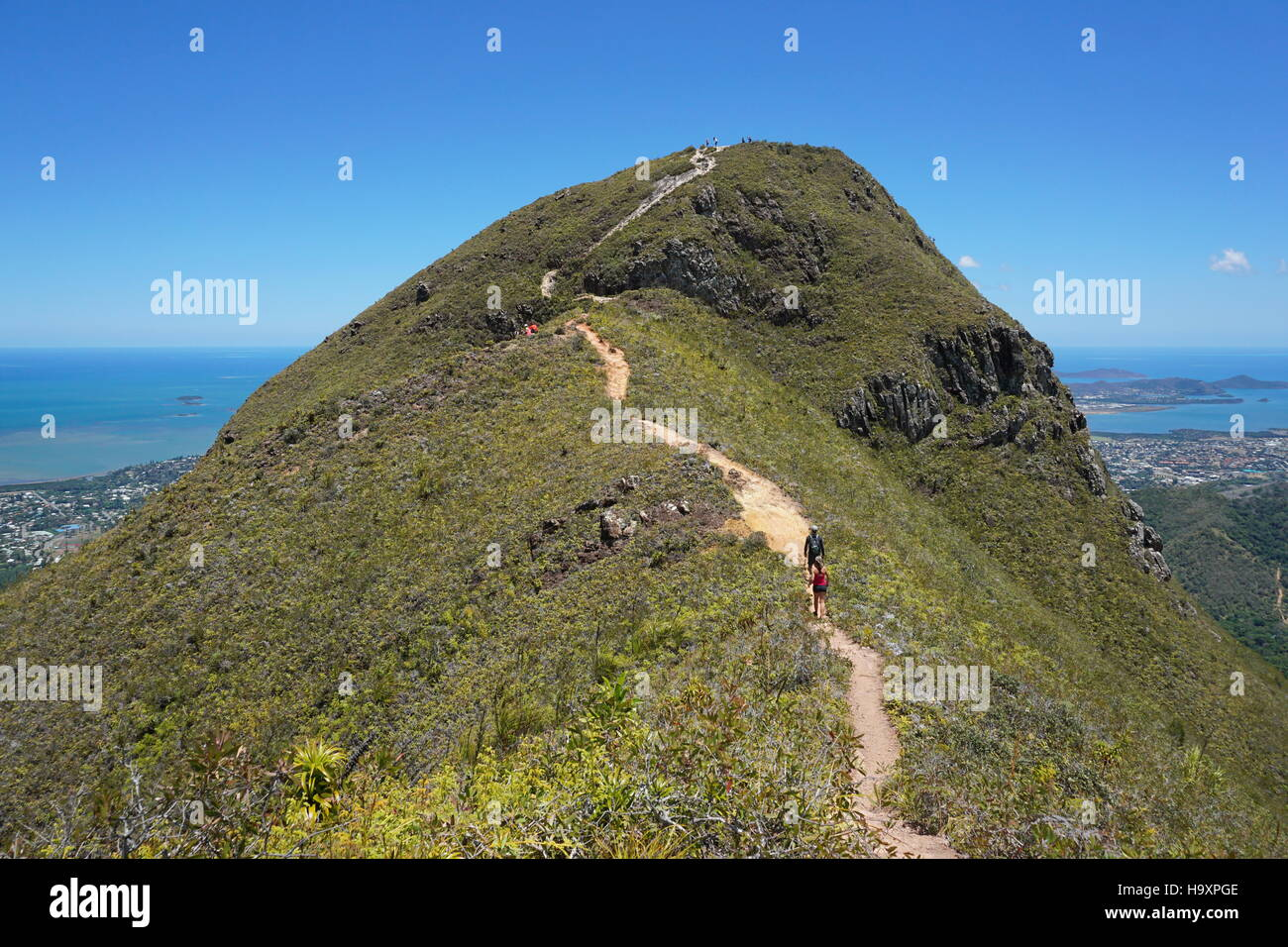 The peak Malaoui with people hiking on the footpath, Noumea, New Caledonia, south Pacific - Stock Image