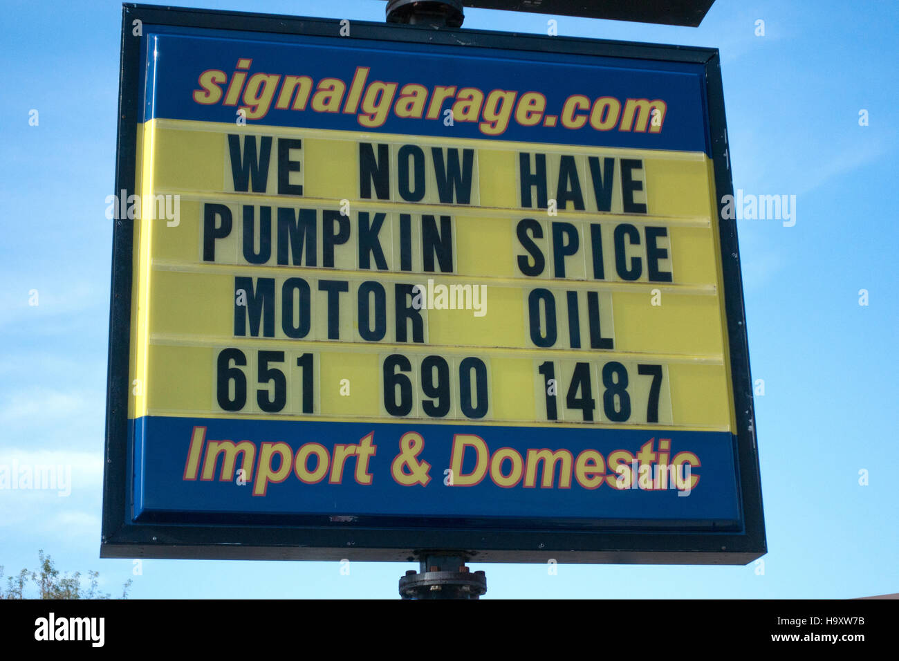 Sign 'We now have pumpkin spice motor oil' humorous: everything needs this autumn seasoning. St Paul Minnesota - Stock Image