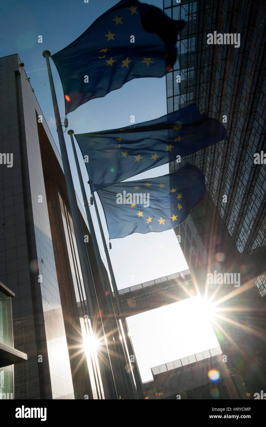 European Union flags with sun near the European Commission building in Brussels. Belgium. - Stock Image