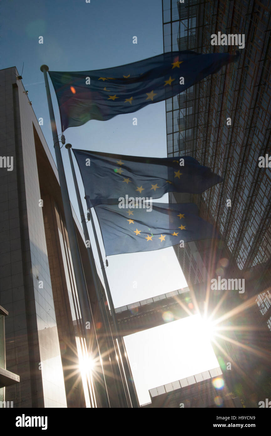European Union flags with sun near the European Commission in Brussels. Belgium - Stock Image