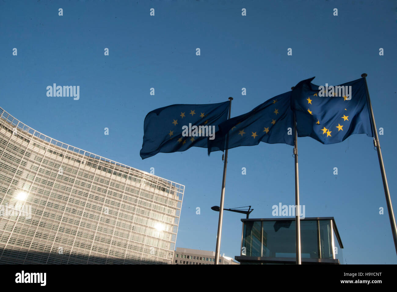 European Union flags next to the European Commission building in Brussels. Belgium - Stock Image