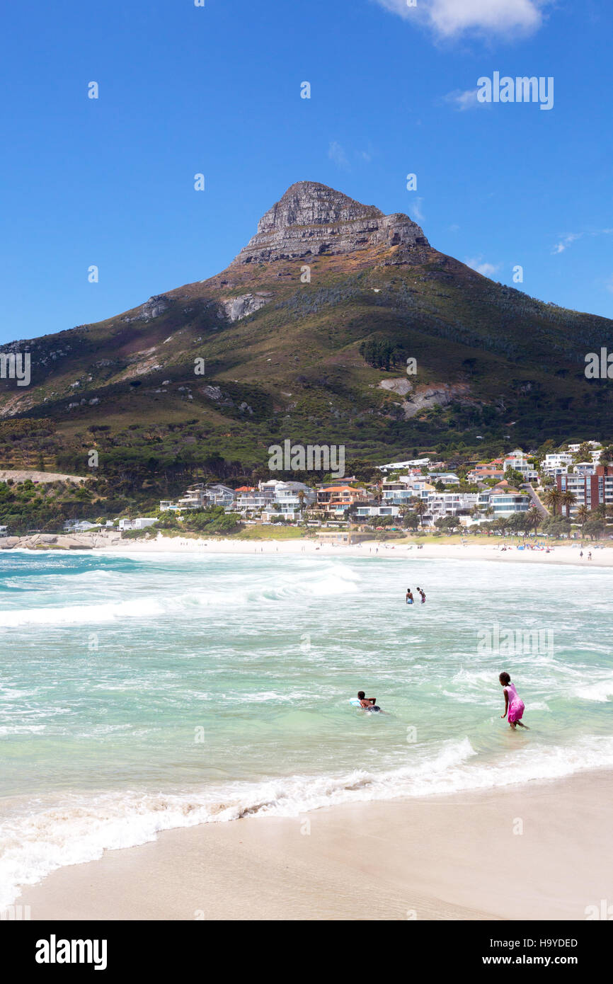 Local people swimming, Camps Bay beach, Cape Town, South Africa - Stock Image
