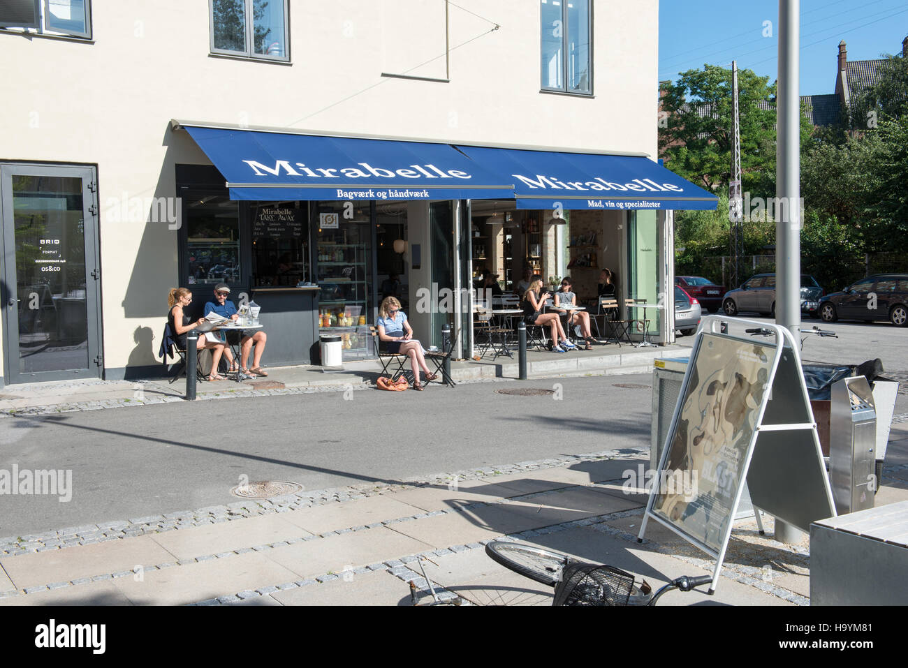 Mirabelle restaurant in Copenhagen on a sunny day with people sitting outside in the sun - Stock Image