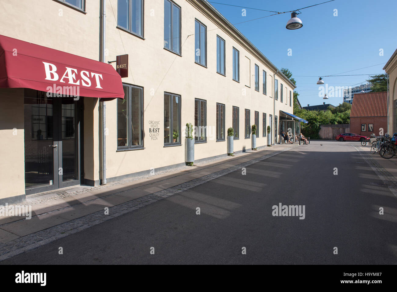 Restaurant Bæst in Copenhagen, Denmark as seen from the street outside in summer - Stock Image