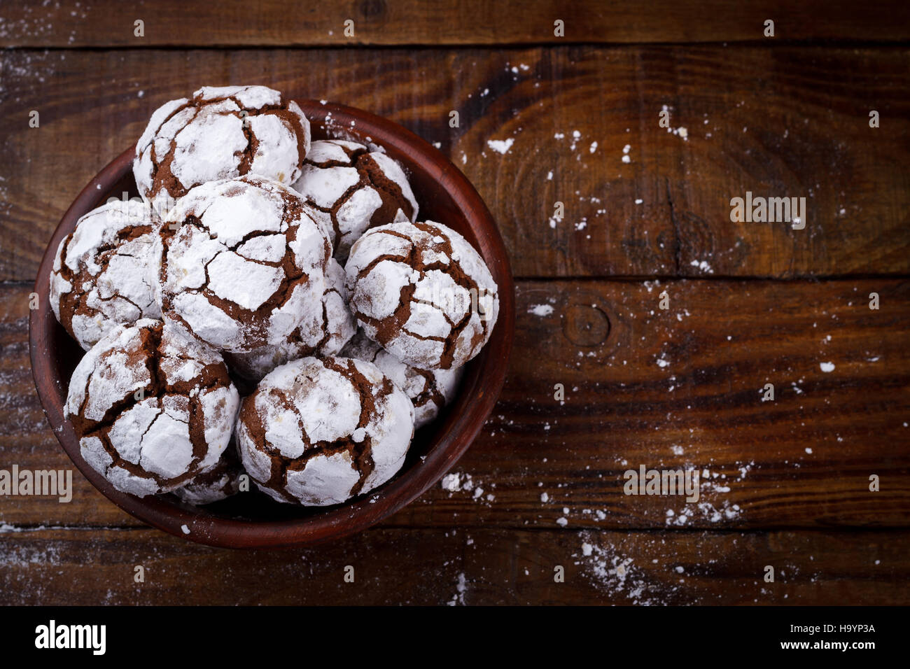 chocolate cookies crinkles on wooden table. copy space Stock Photo