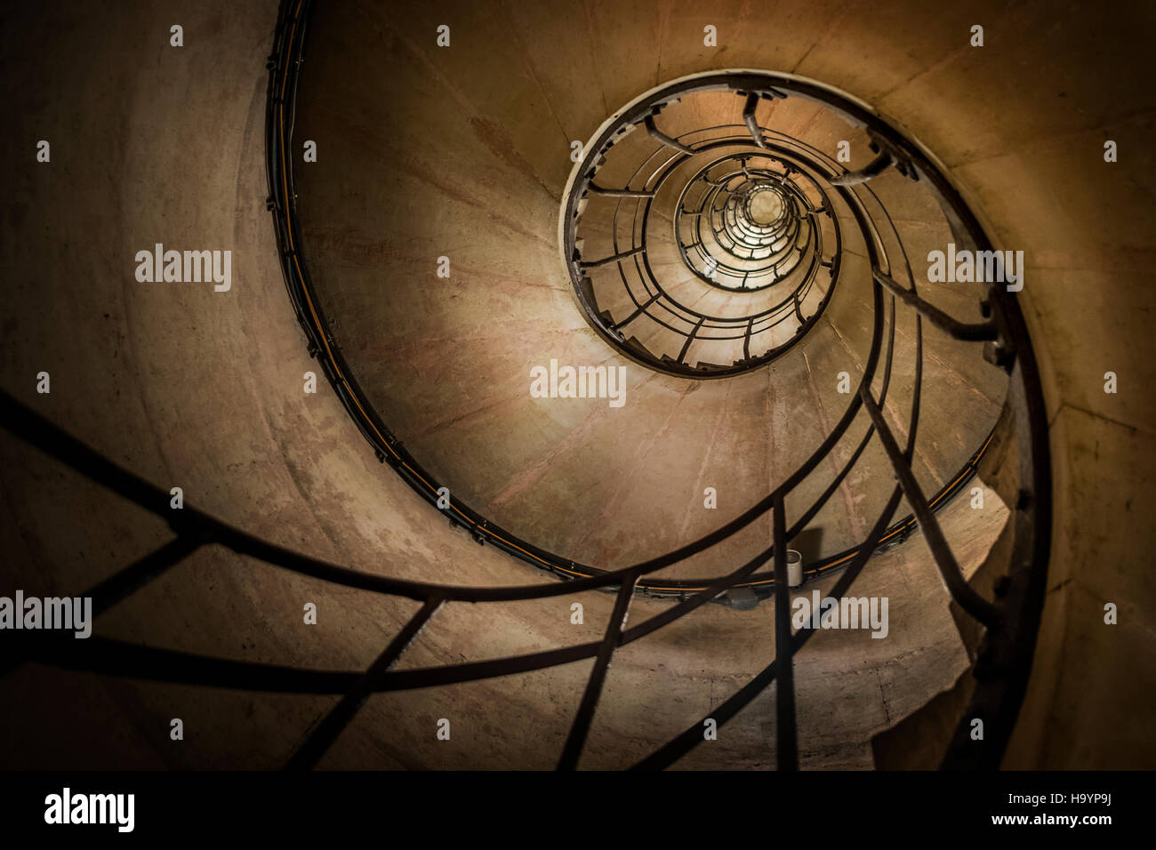 Looking up one of the spiral stairs of the Arc de Triomphe, Paris - Stock Image
