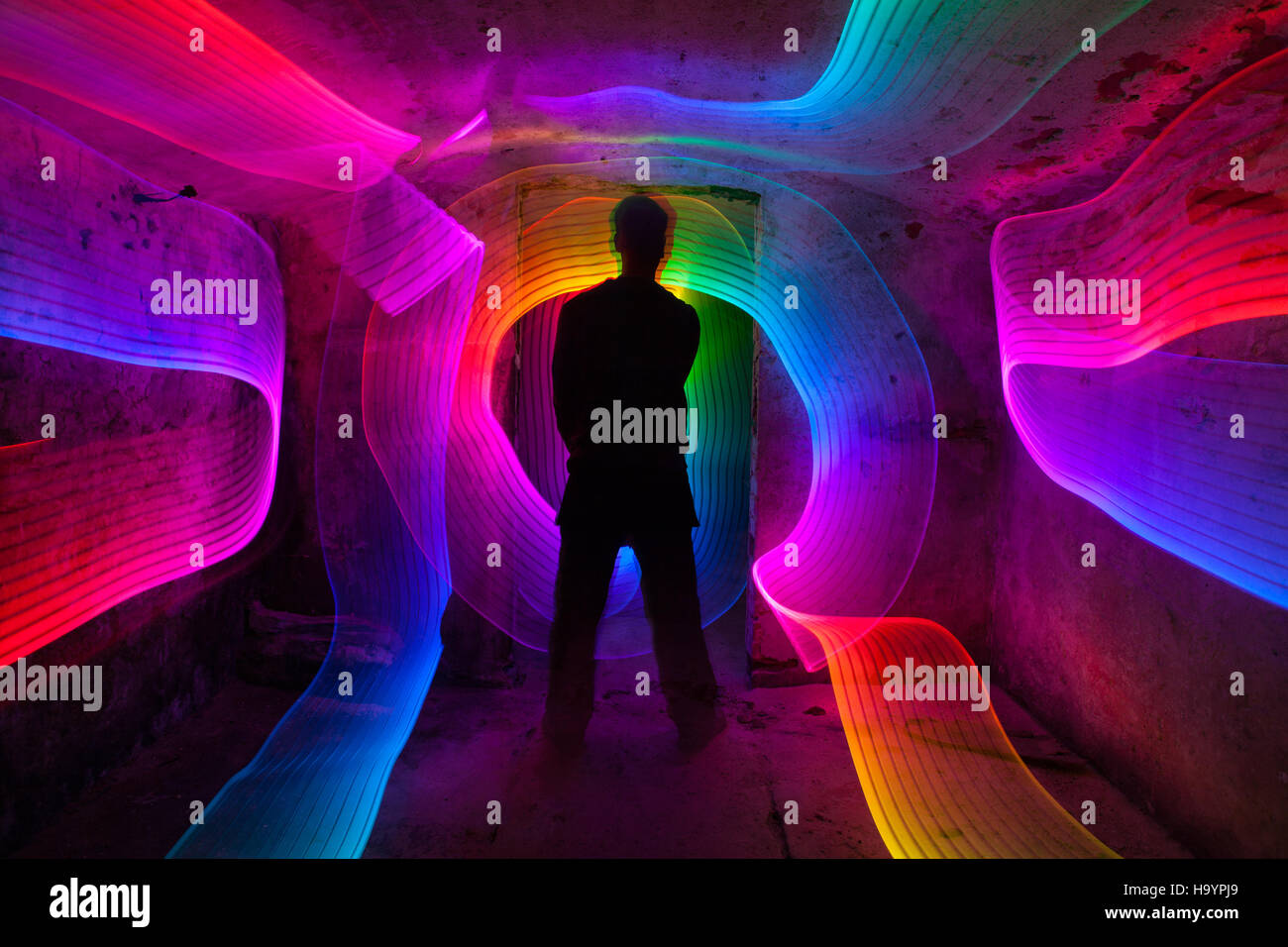 Light painting in damp rustic basement. - Stock Image
