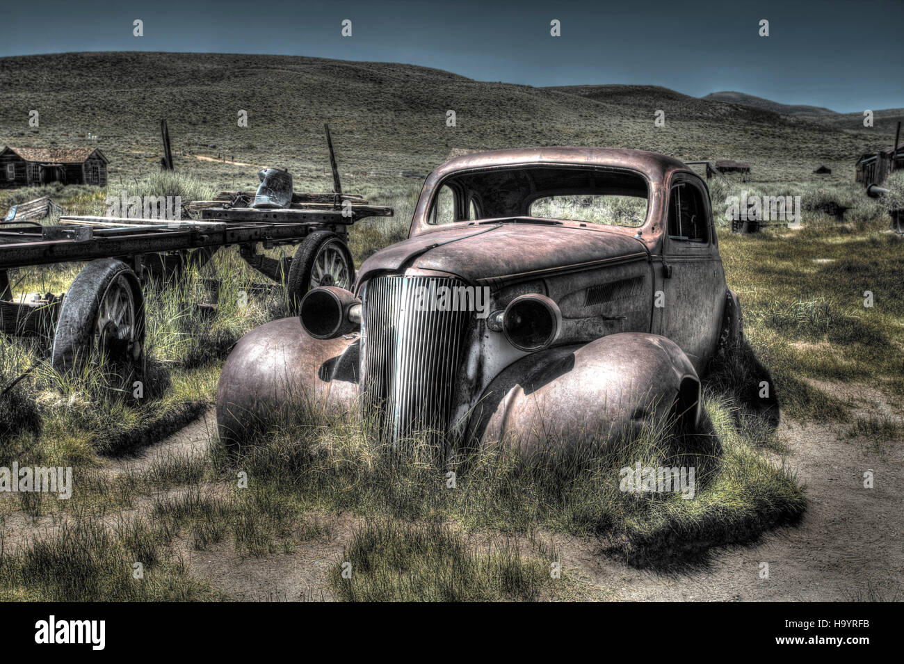An abandoned rusty old 1930's car at Bodie Ghost Town, California - Stock Image