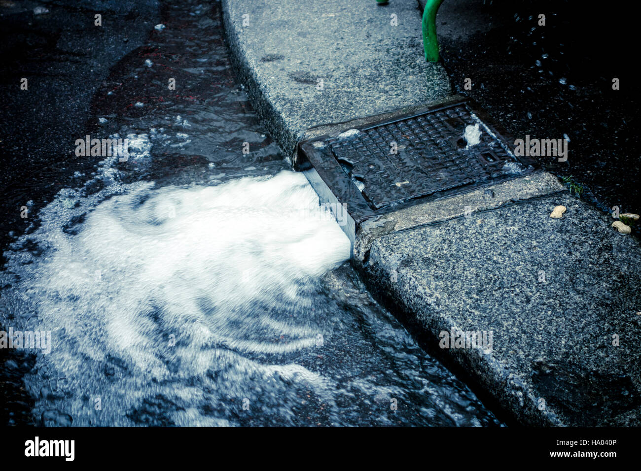 Water flowing out of a sewer, Paris - Stock Image