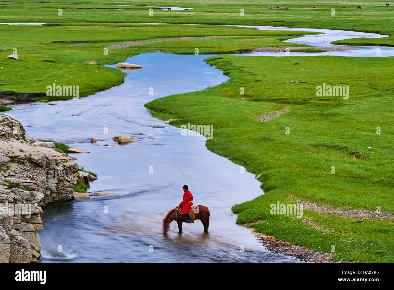 Mongolia, Arkhangai province, Mongolian horserider in the steppe - Stock Image