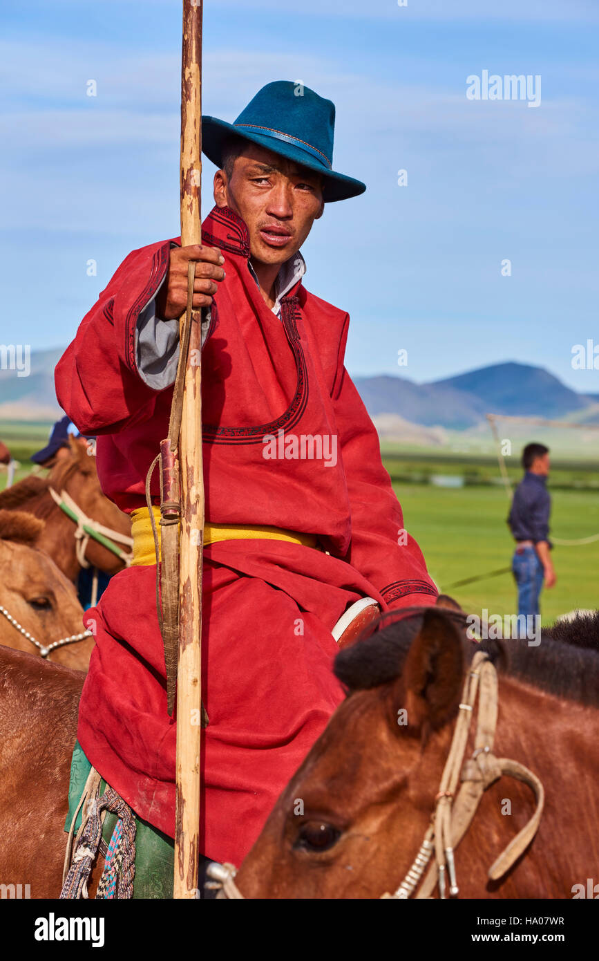 Mongolia, Bayankhongor province, Naadam, traditional festival, portrait of a young man in deel, traditional costume - Stock Image