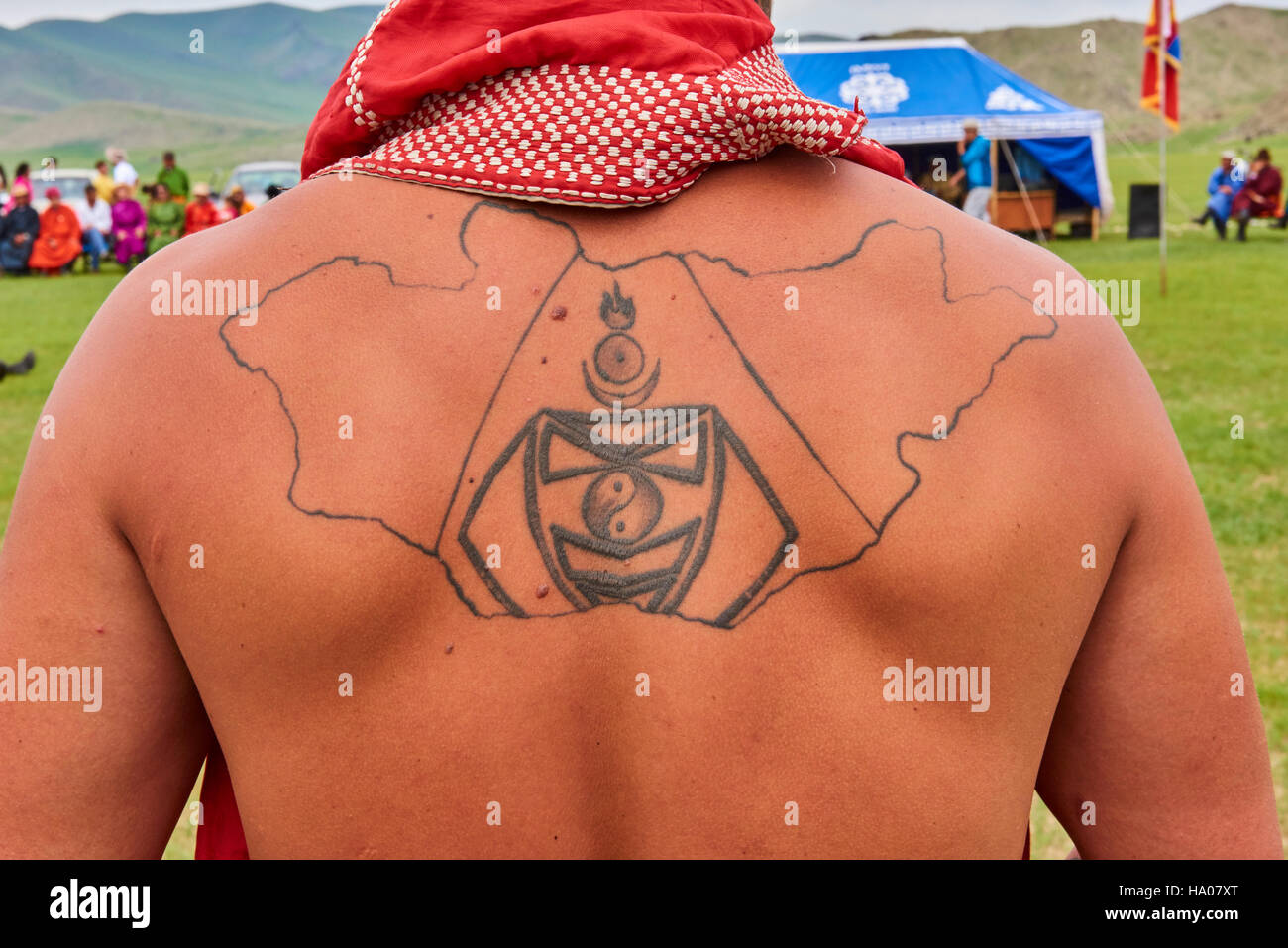 Mongolia, Bayankhongor province, Naadam, traditional festival, wrestler wearing a tattoo of the map of Mongolia - Stock Image
