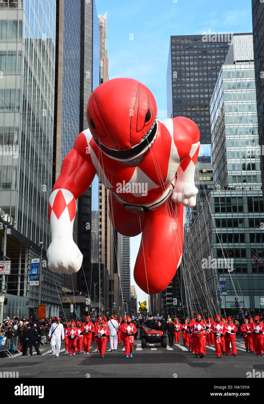 Red Mighty Morphin Power Ranger making his way down 6th Avenue. - Stock Image