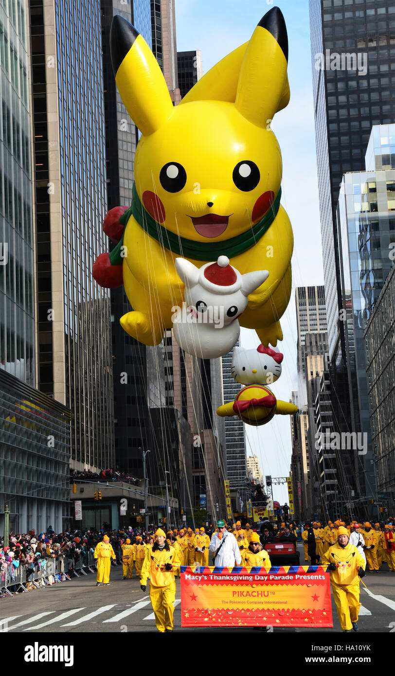 pikachu balloon fallowed by hello kitty on the parade route stock