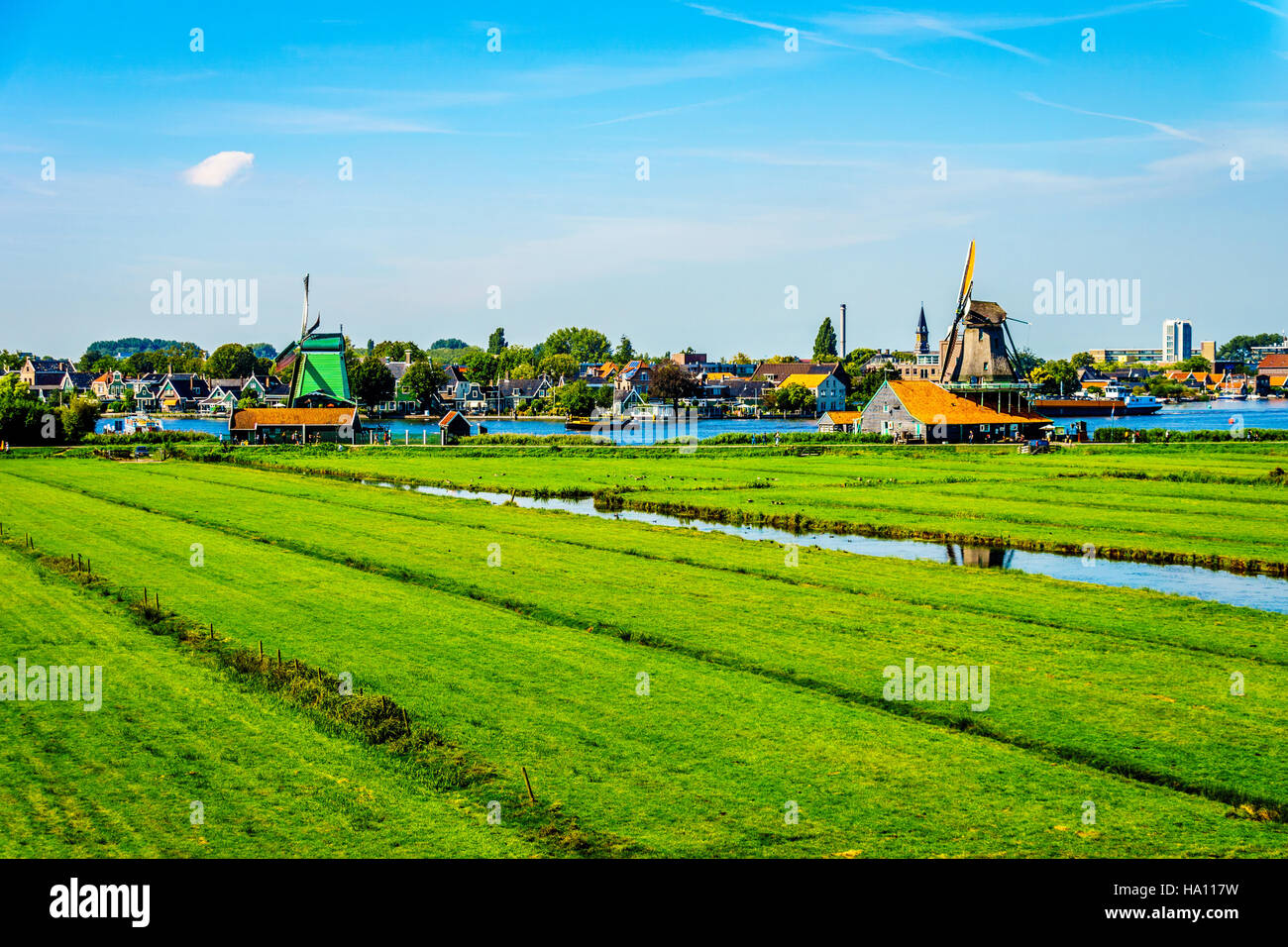 typical dutch landscape with open fields canals and dutch windmill