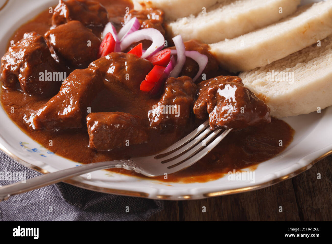 Hot Czech beef goulash with Knodel on a plate close-up. horizontal Stock Photo