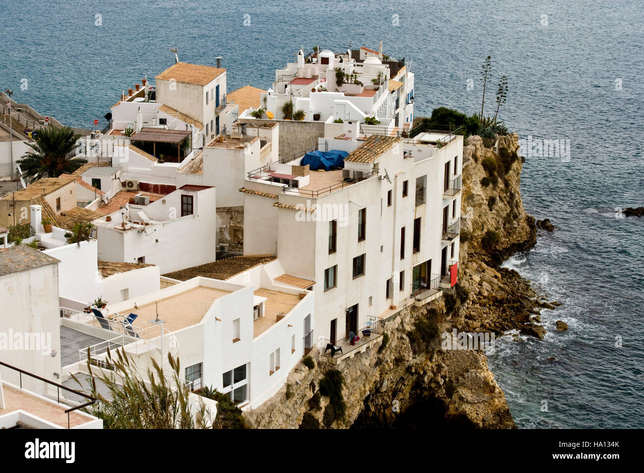 View of old city of Eivissa (Ibiza), whose houses are built on a spur of rock at the entrance of the port - Stock Image