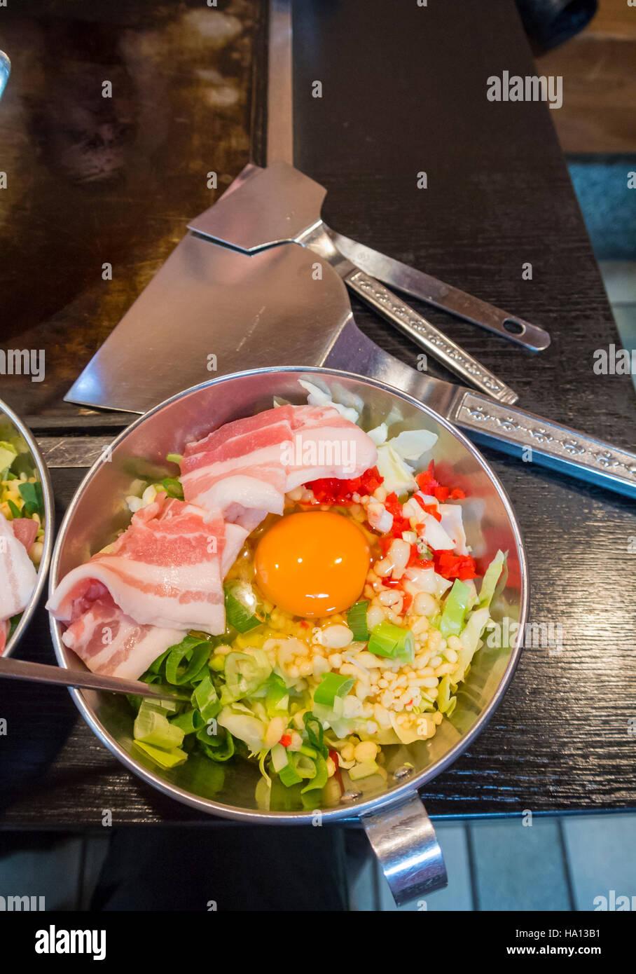 Raw ingredients for Okonomiyaki at a japanese restaurant, Japan - Stock Image