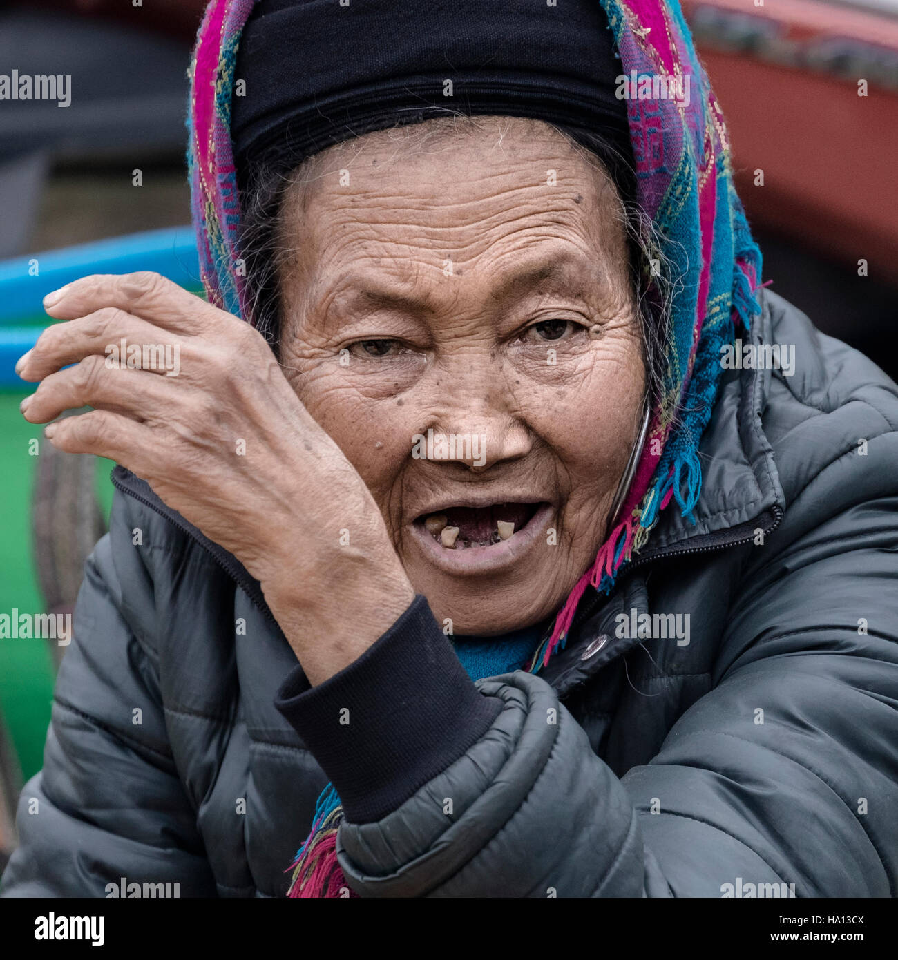 Vietnamese older lady on the local market in Sapa, Vietnam, Asia - Stock Image