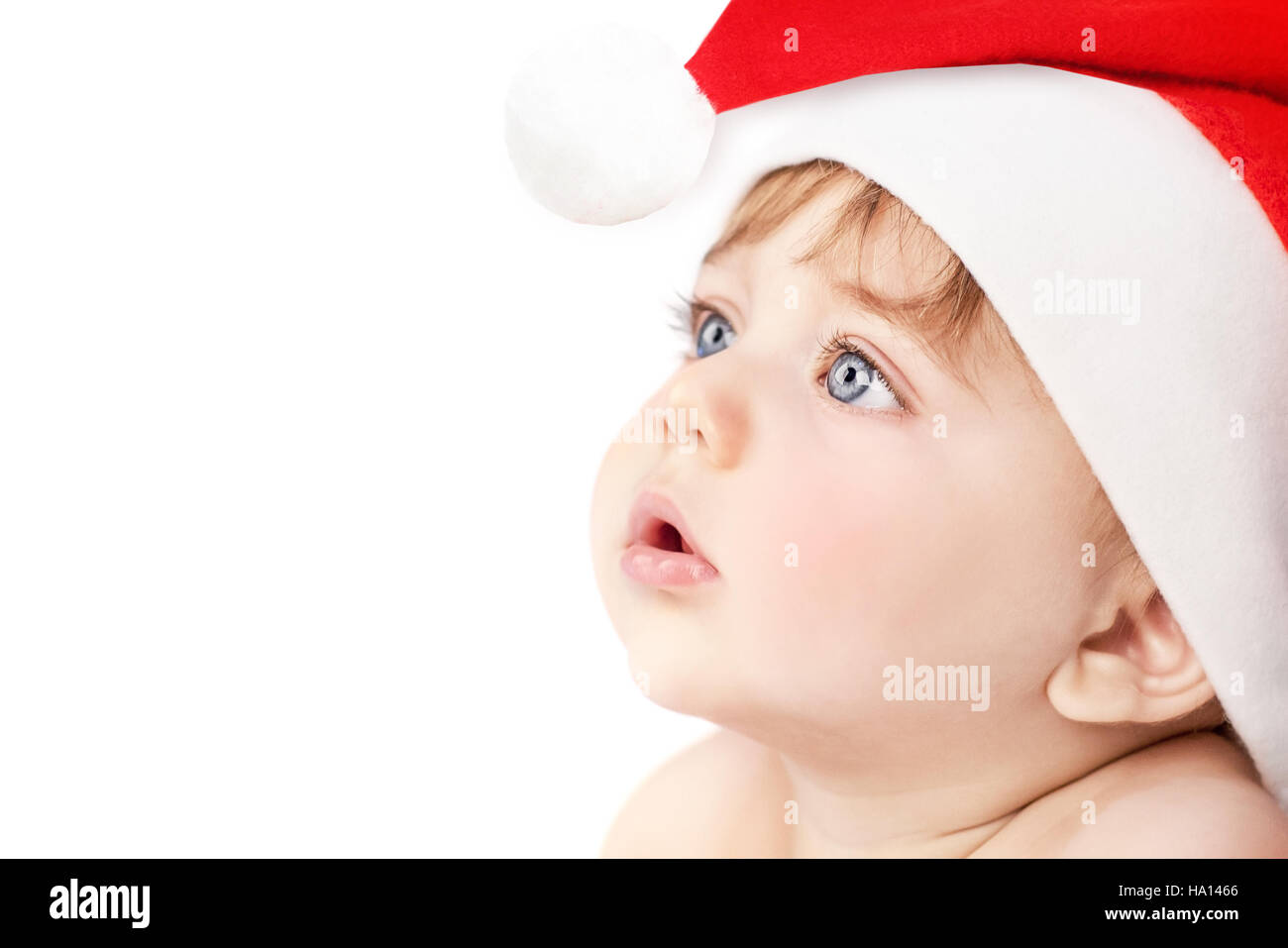 357cdab9f Closeup portrait of a cute little baby boy wearing red Santa Claus hat  isolated on white background, traditional Christmas costume