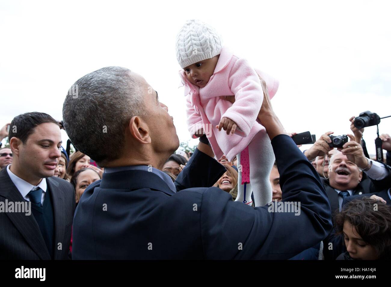 Us president barack obama holds up a baby during a us embassy us president barack obama holds up a baby during a us embassy meet and greet at the arion resort november 16 2016 in athens greece m4hsunfo