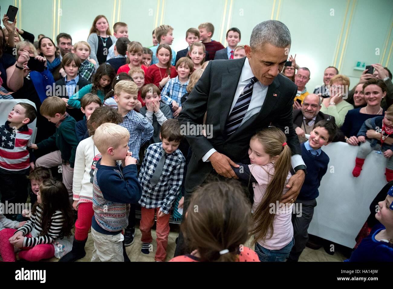 Us president barack obama greets children during the us embassy us president barack obama greets children during the us embassy meet and greet at hotel adlon november 16 2016 in berlin germany m4hsunfo