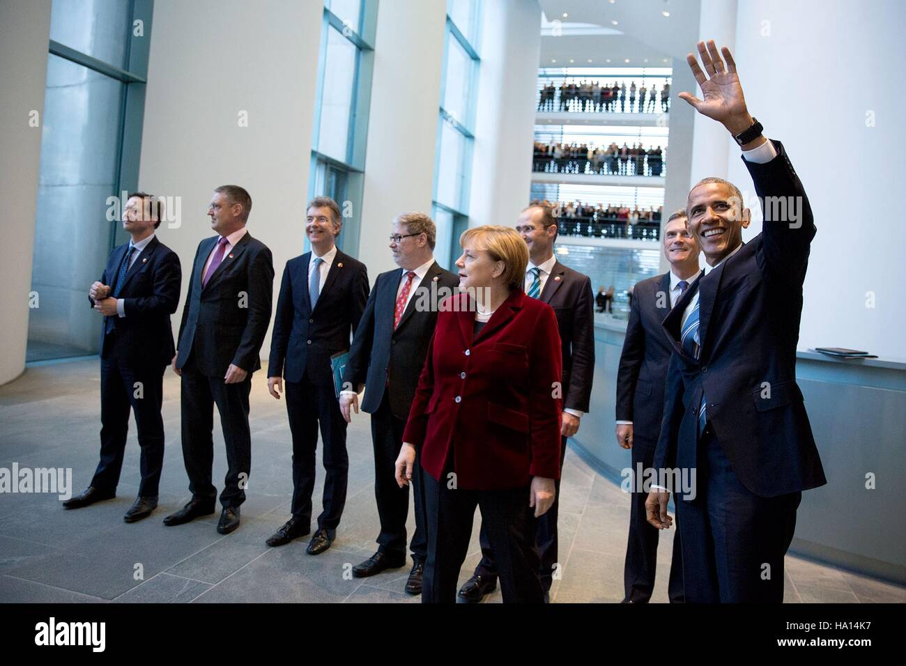 U.S. President Barack Obama waves to government workers alongside German Chancellor Angela Merkel and the German - Stock Image