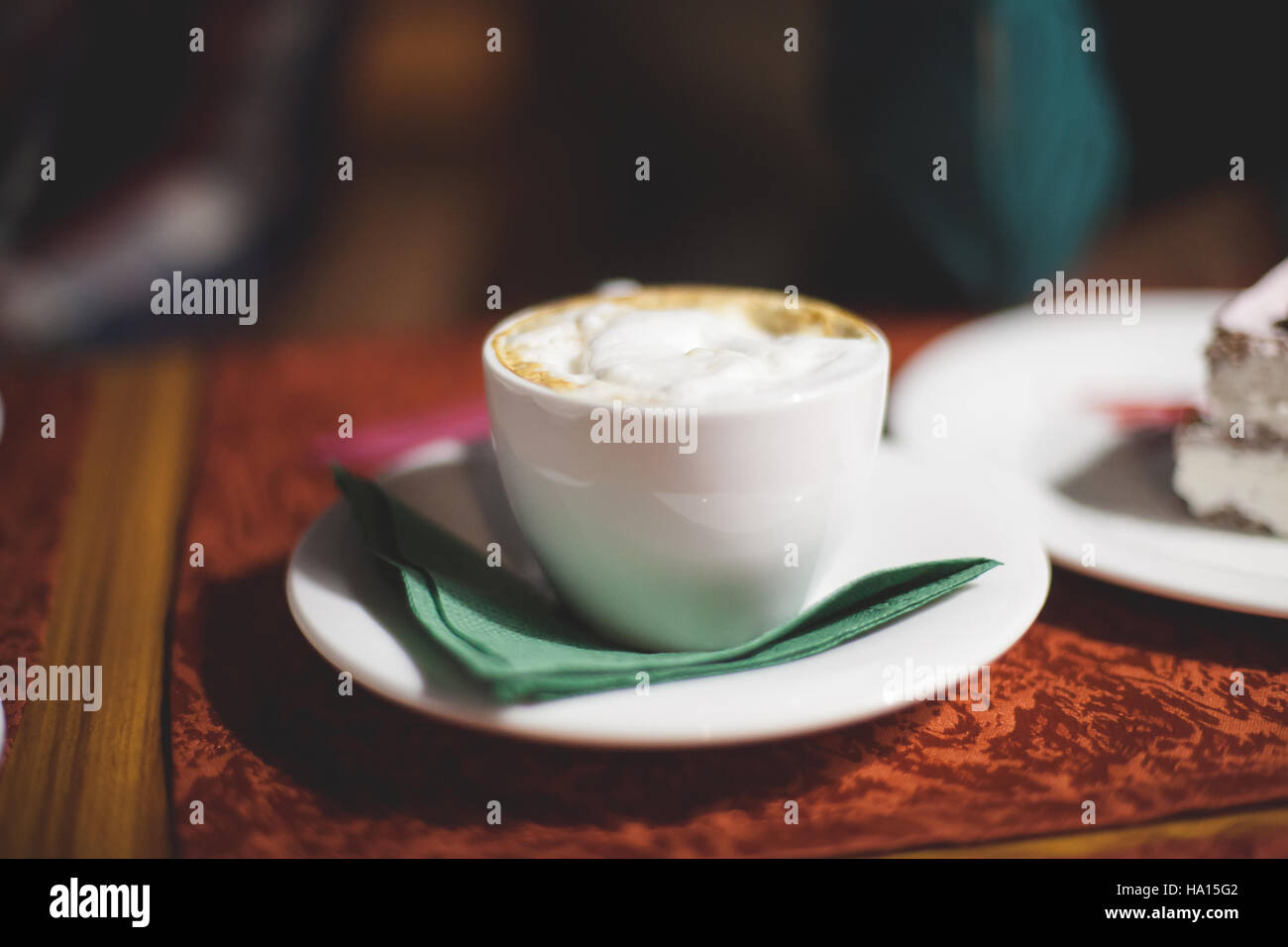 Flat white cup of coffee latte, close up, shallow dof - Stock Image