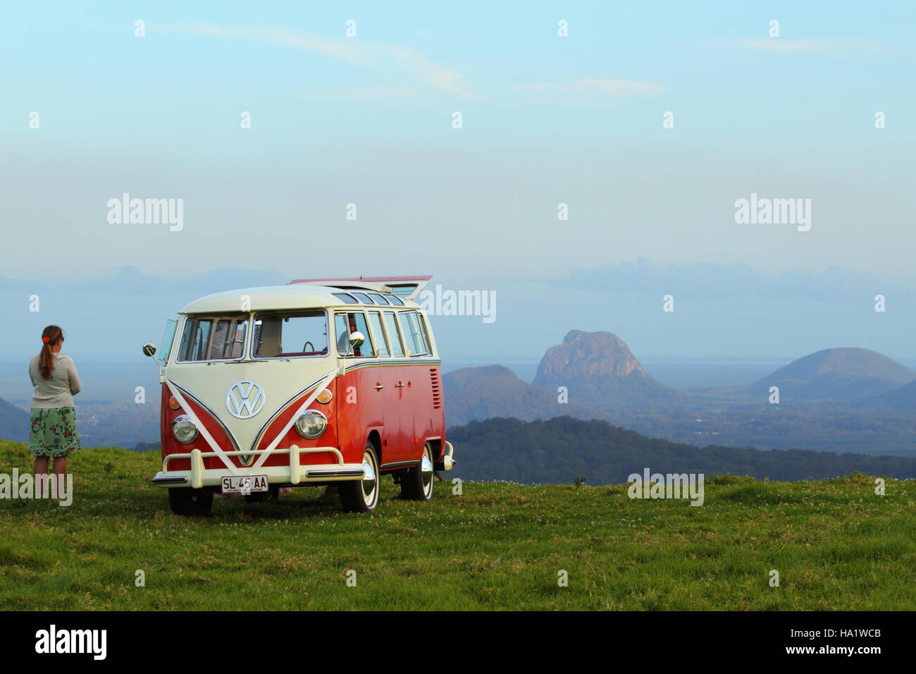 A VW Combi bus at dusk on front of the Glasshouse Mountains at Maleny, in the Sunshine Coast Hinterland, Queensland, - Stock Image