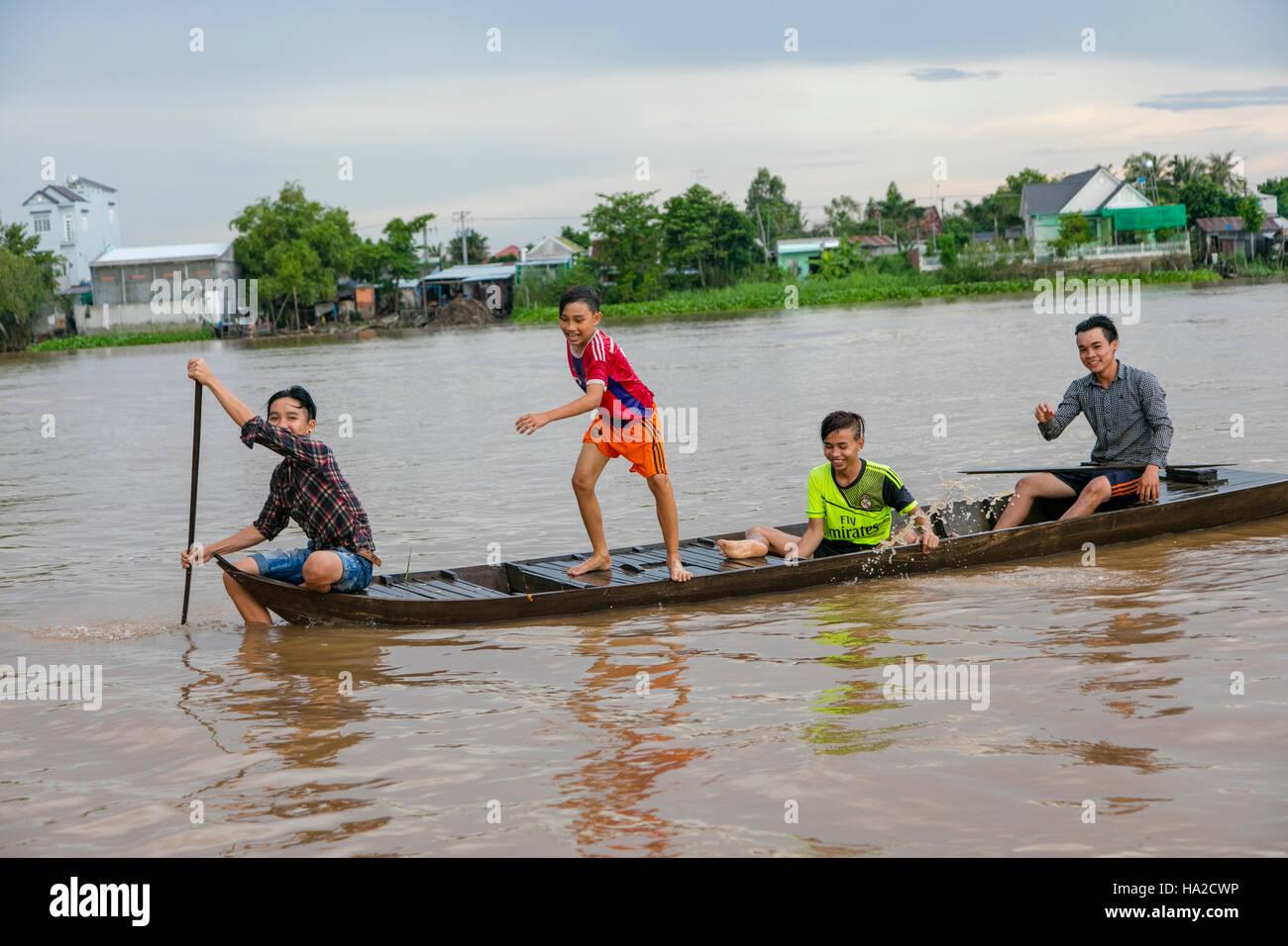 Chlidren in Canoe, Mekong River, Vietnam, Asia - Stock Image