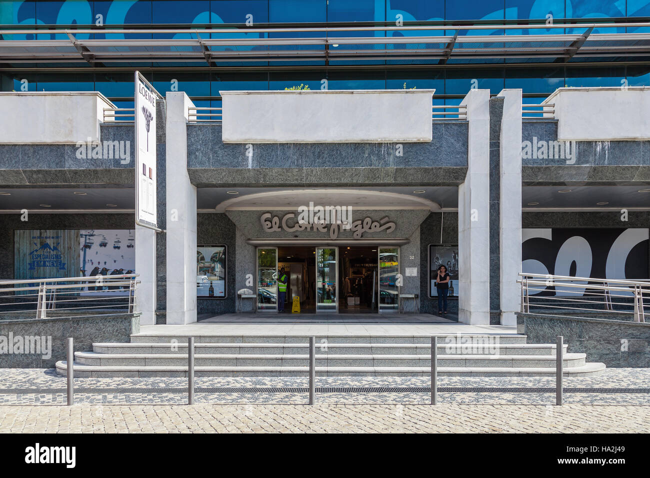 An entrance to the El Corte Ingles, a high end Shopping Mall of a global retail company, near the Eduardo VII Park. Stock Photo