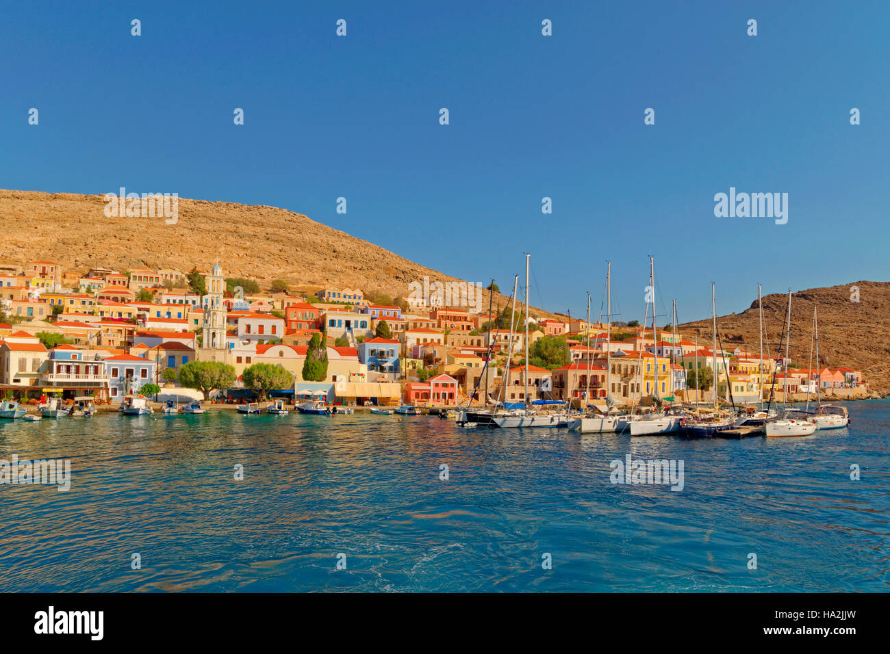 Chalki town and yacht berths, Greek island of Chalki situated off the north coast of Rhodes, Dodecanese Island group, - Stock Image