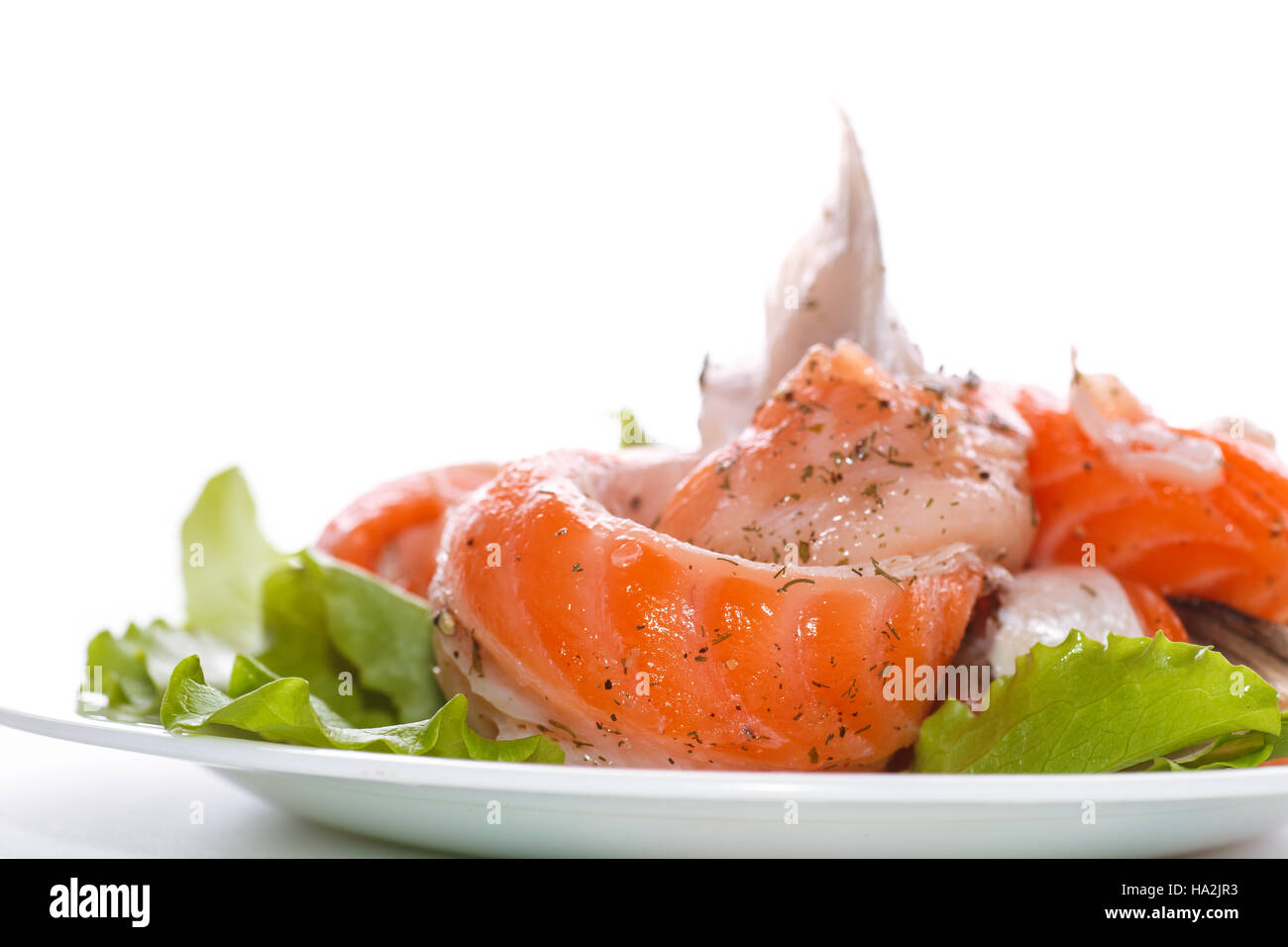 salted salmon bellies with spices on a white background - Stock Image