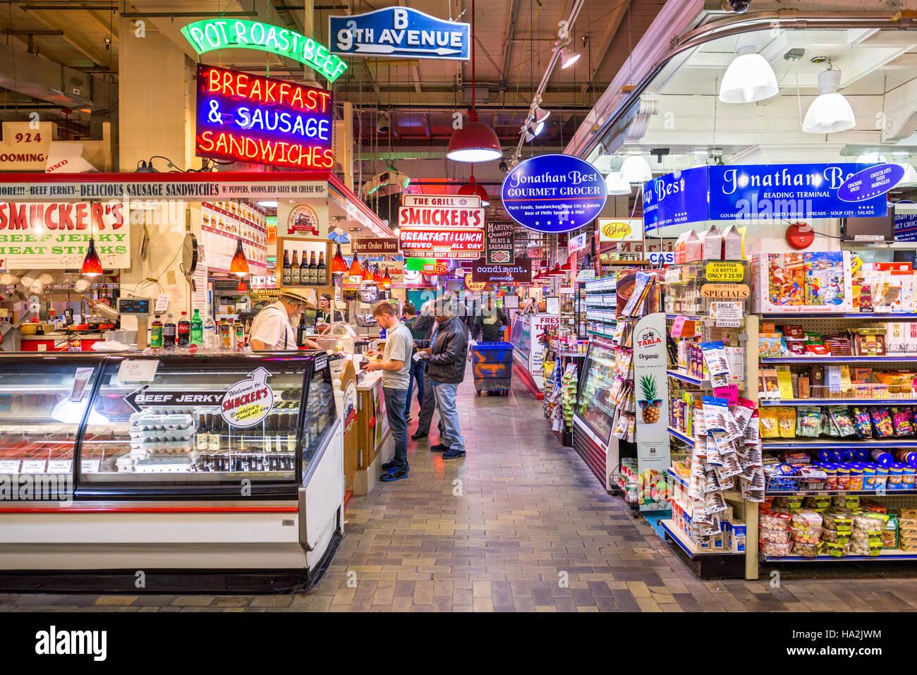 Vendors and customers in Reading Terminal Market in Philadelphia, Pennsylvania, USA. - Stock Image