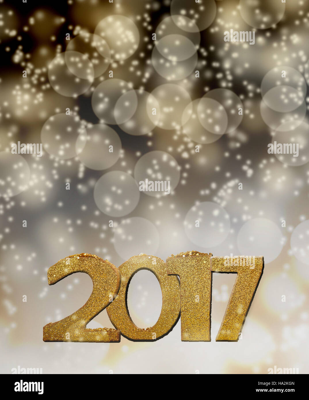 golden figures 2017 on lights background - Stock Image