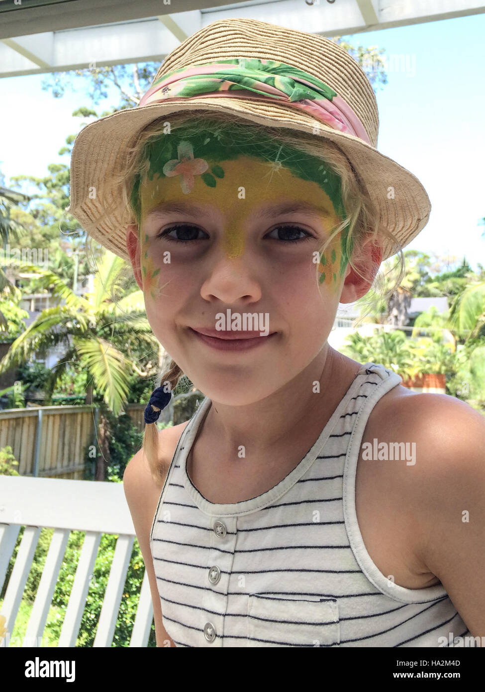 Portrait of a boy with face paint in a straw hat Stock Photo