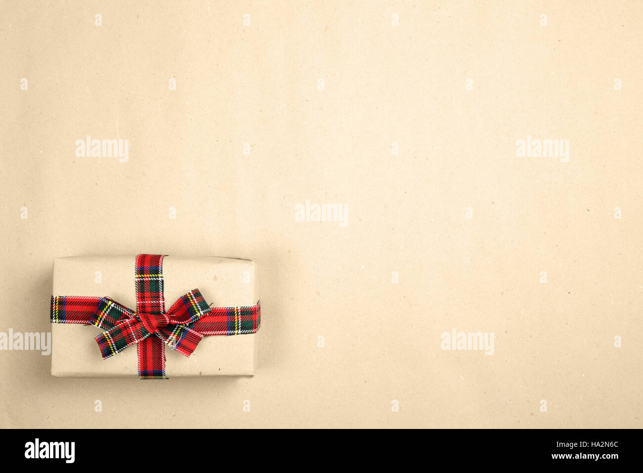 Hipster Christmas Gift Box On Paper Background With Red Cloth Bow