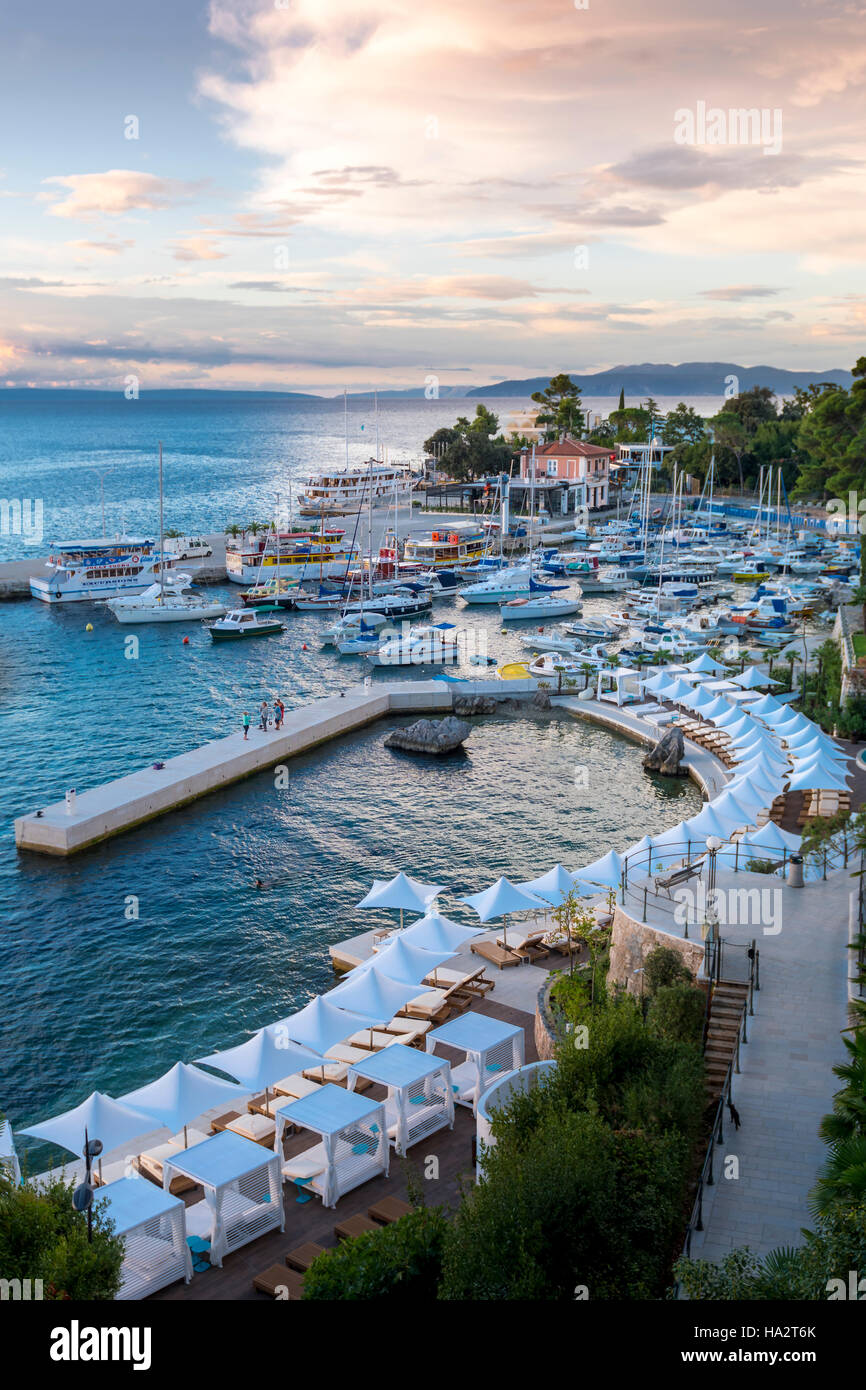Opatija, Croatia - September 6 2016: Crowded harbor in the morning after heavy storms and deserted hotel beach in - Stock Image