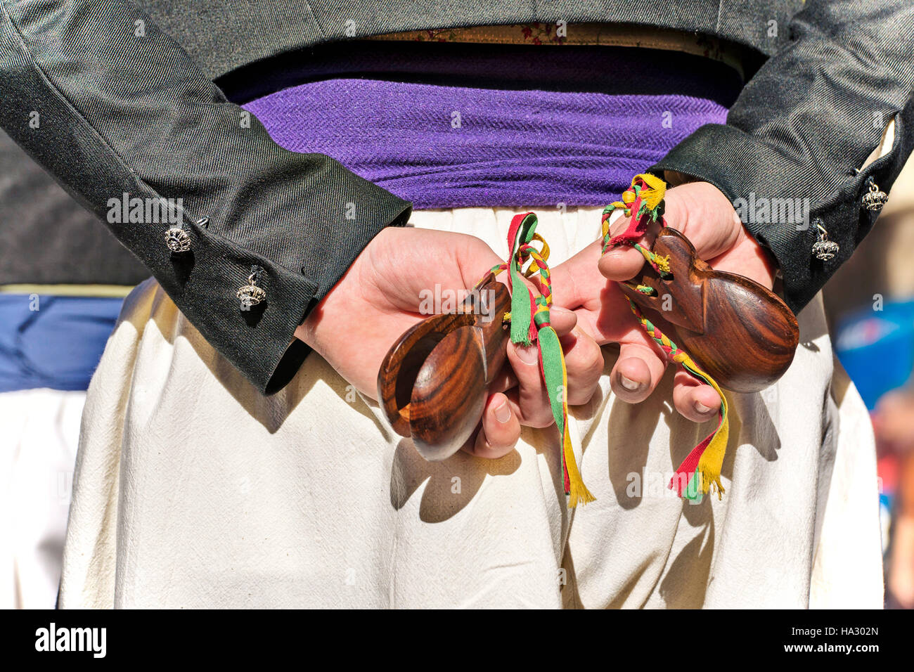 Spanish dancer with castanuelas instruments (castanets ) in his hands - Stock Image
