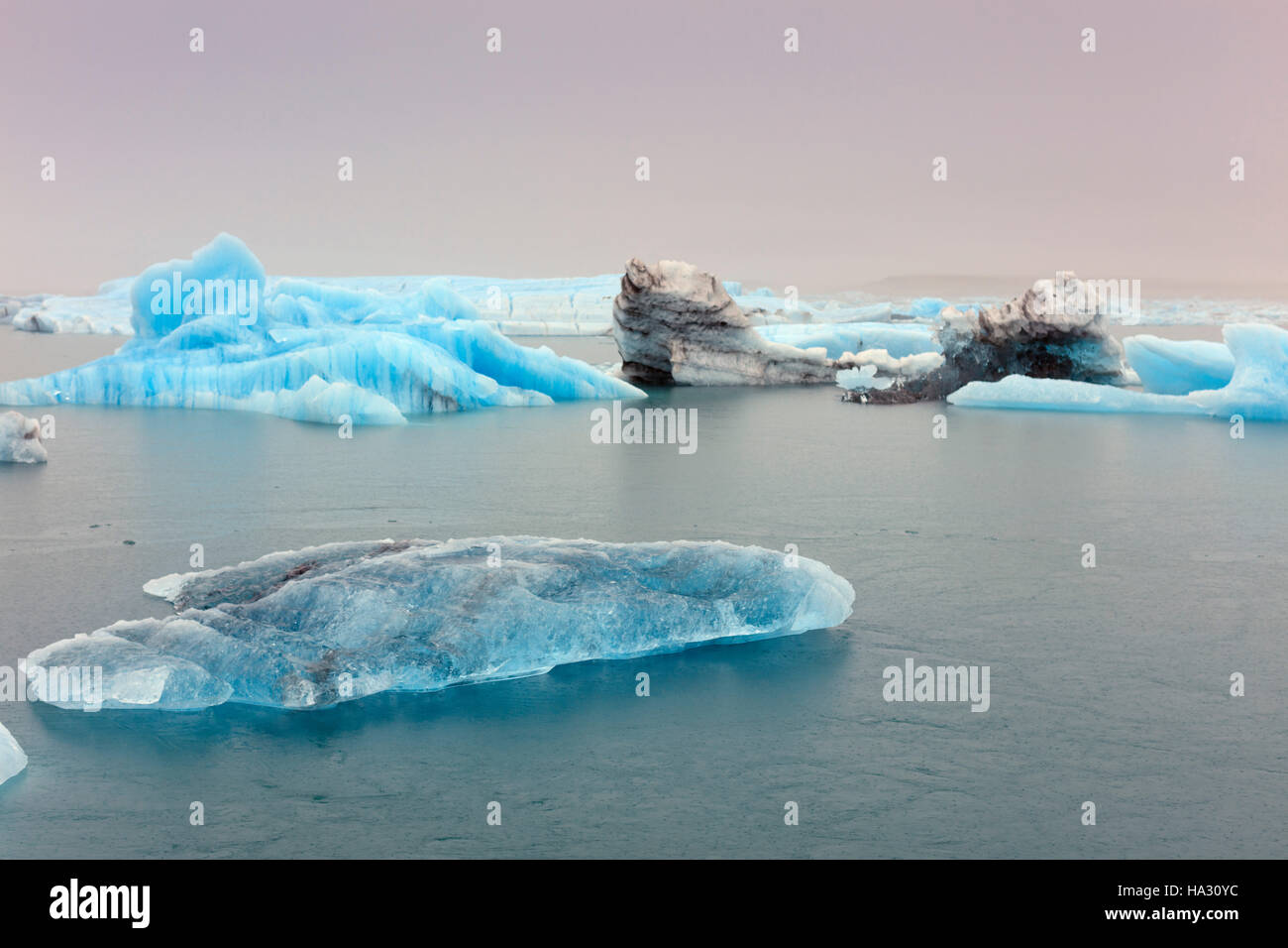 Icebergs in Jokulsarlon, a glacial lake in southeast Iceland, on the edge of Vatnajokull National Park Stock Photo
