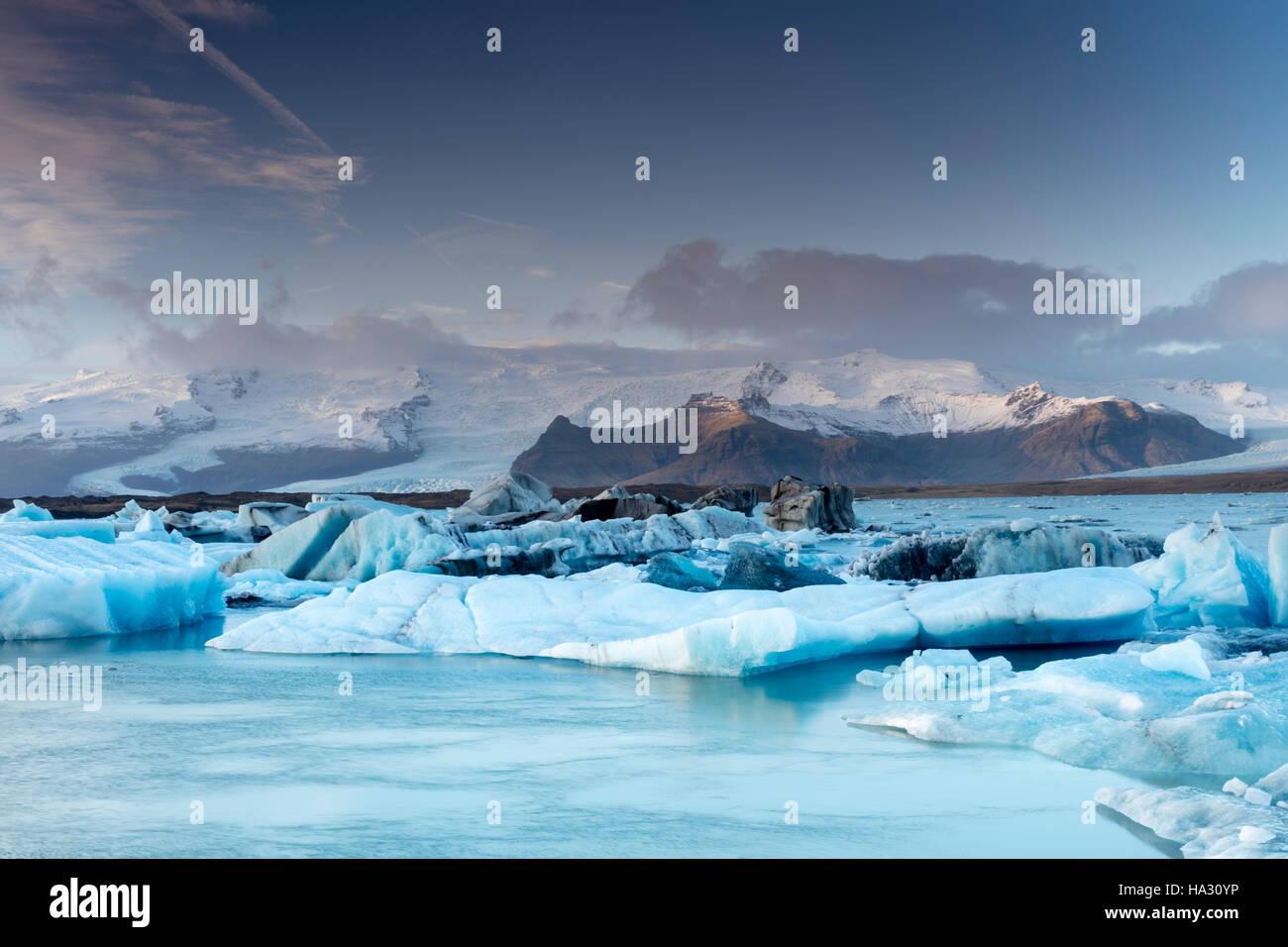 Icebergs in Jokulsarlon, a glacial lake in southeast Iceland, on the edge of Vatnajokull National Park - Stock Image