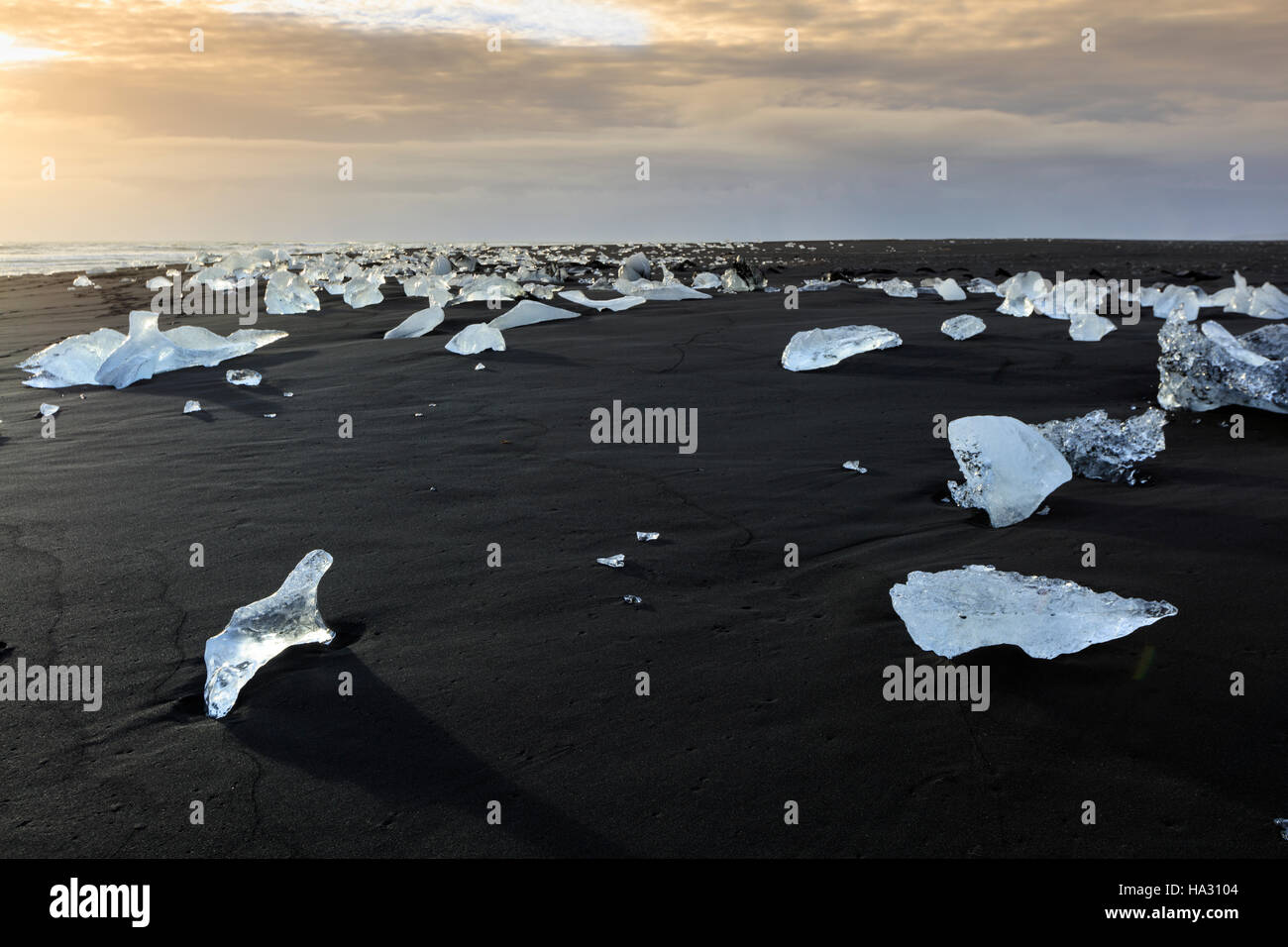 Icebergs on a black sand volcanic beach next to the Jokulsarlon iceberg lagoon in Vatnajokull national park, Iceland - Stock Image