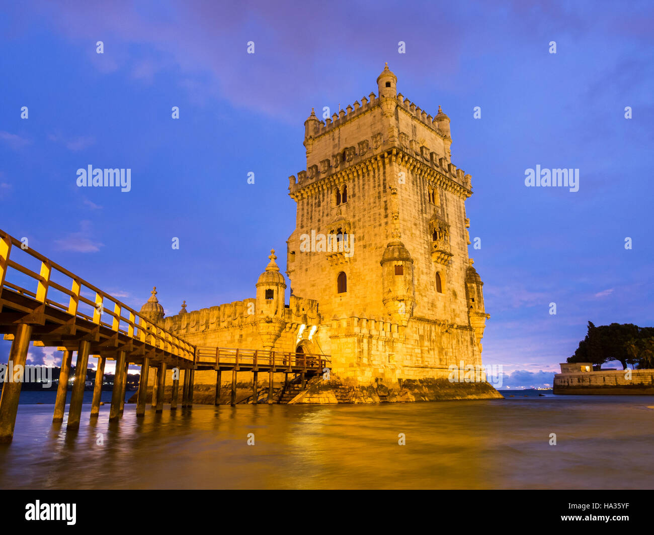 Torre de Belem on the bank of Tagus river in Lisbon, Portugal, at night. - Stock Image