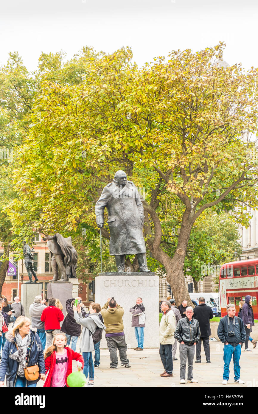 tourists in front of winston churchill statue, parliament square - Stock Image