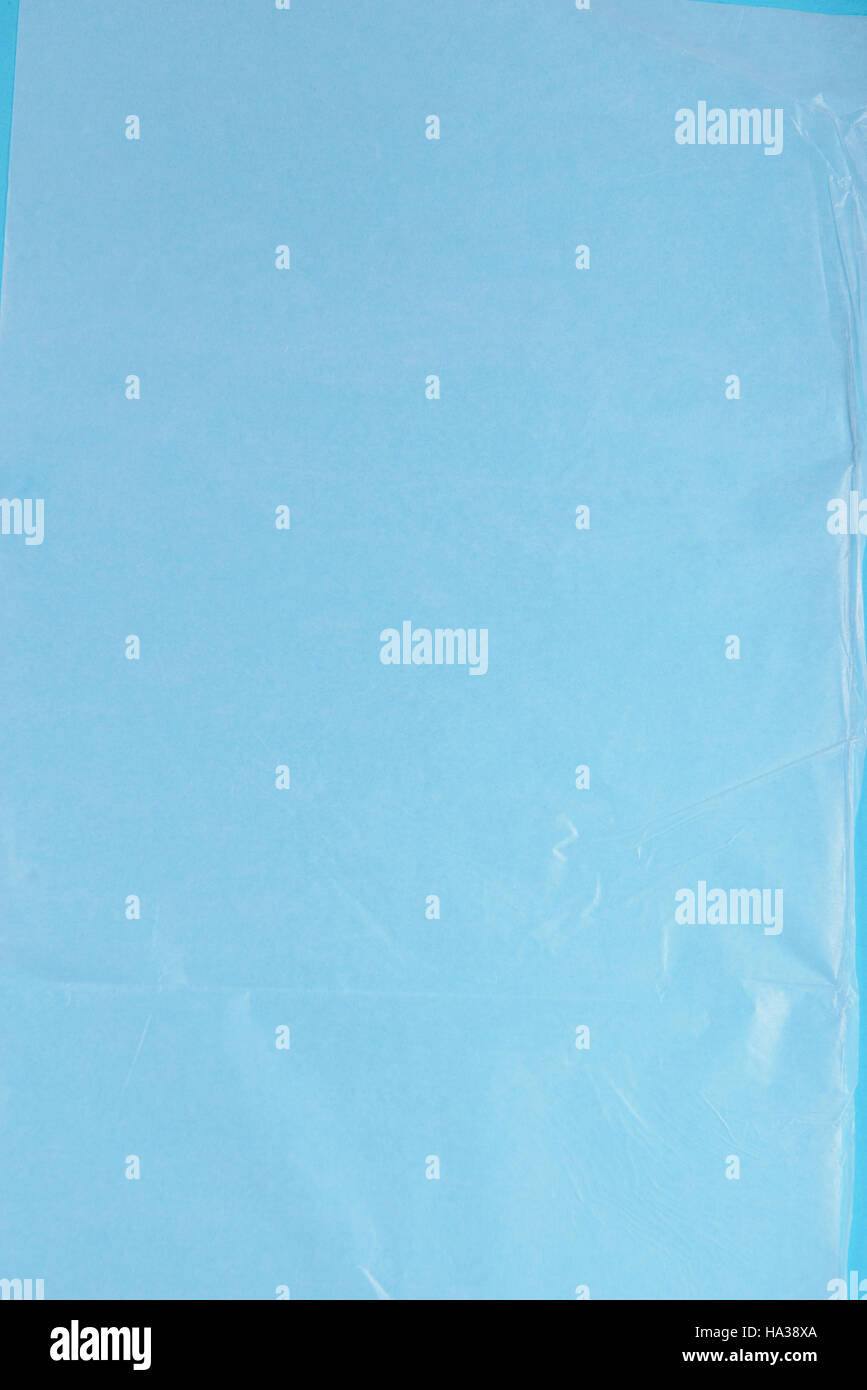 Plastic Wrap On Blue Background, High Resolution