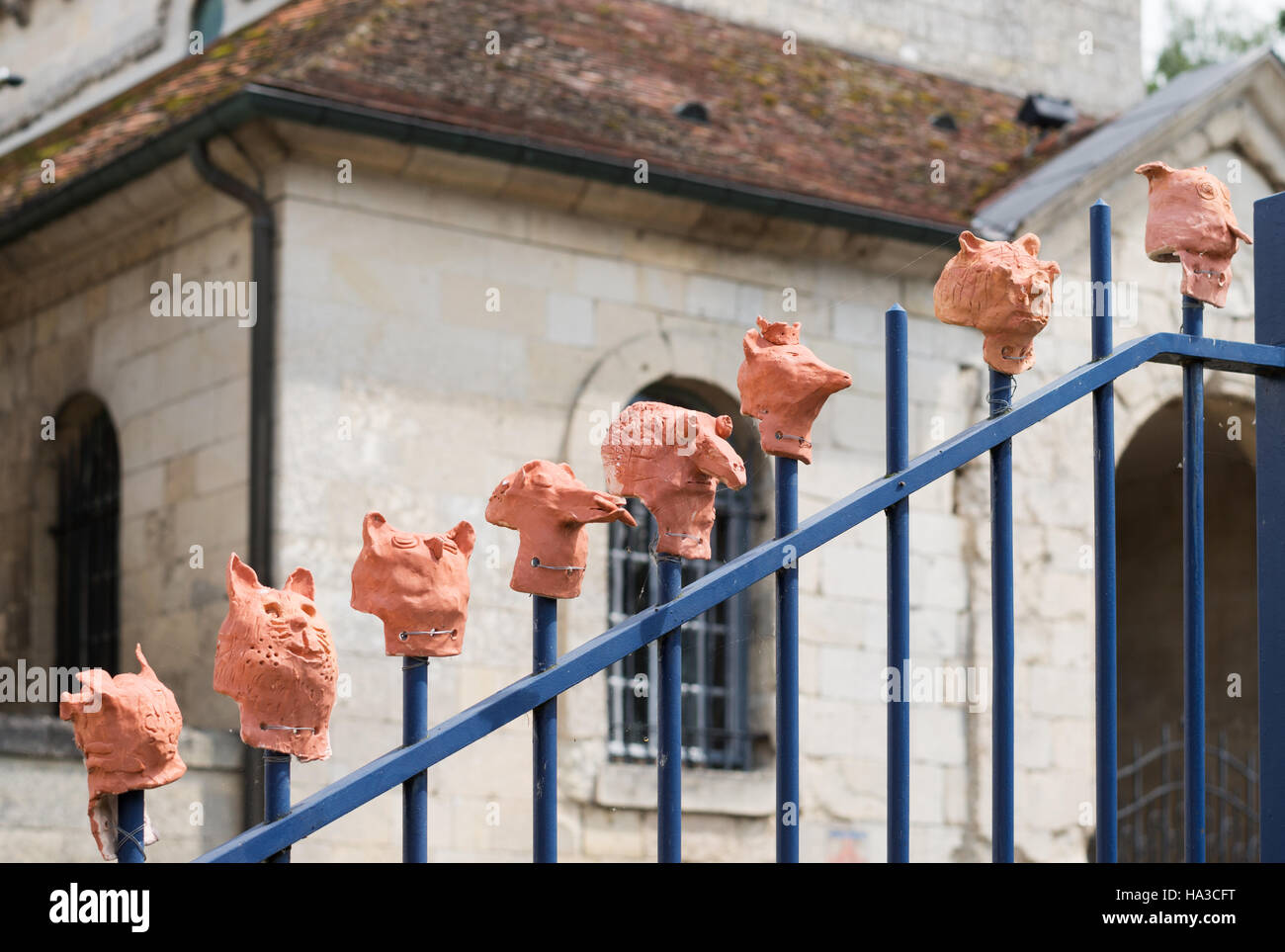 Clay head sculptures made by schoolchildren, Ressons Le Long, Picardy, France,  Europe - Stock Image