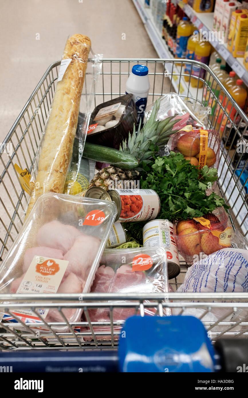 Supermarket shopping trolley,UK - Stock Image