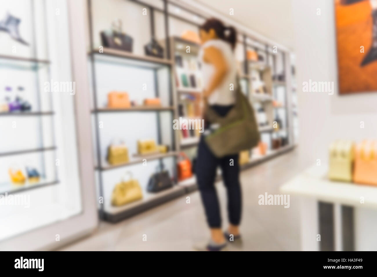 abstract blur of women select the bag on shelf - can use to display or montage on product - Stock Image